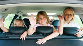 Family travelling by car. Family with three kids travelling in a car Royalty Free Stock Image