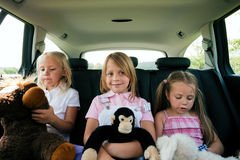 Family travelling by car. Family with three kids in a car travelling to their vacation destination Stock Images