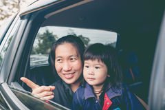 Family travelling by car on vacation. Outdoors. Stock Photo
