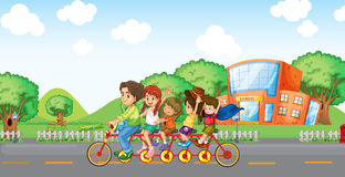 A family travelling with a family bike. Illustration of a family travelling with a family bike Stock Photo