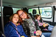 Family travelling in minivan to airport royalty free stock photography