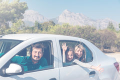 Family travelling together by Car excited and happy Stock Photo