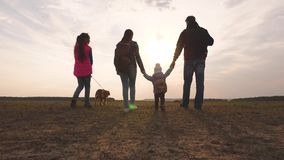 Family travels with the dog across the plains and mountains. dad, mom, daughters and pets, tourists. teamwork of a close. Family travels with the dog across the stock video footage
