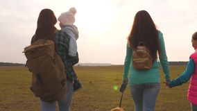 Family travels with the dog on the plain. teamwork of a close-knit family. mother, little child and daughters and pets. Family travels with the dog on plain stock video footage