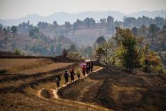A family travels walking through the shan state mountains, Trek Kalaw Inle Lake, Shan State, Myanmar. Shan State is a state of Myanmar. Shan State borders China Royalty Free Stock Photos