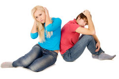 In the family treason girl and guy sitting frustrated Royalty Free Stock Photo