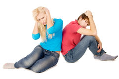 In the family treason girl and guy sitting frustrated Stock Image