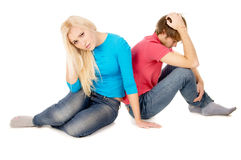 In the family treason girl and guy sitting upset Royalty Free Stock Images