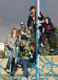 Family tree. The whole family on a piece of playground equipment pretty happy group Royalty Free Stock Images