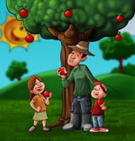 The family and the treee Stock Image