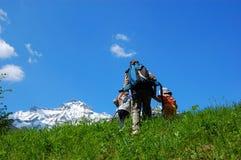 Family trekking. Mountain family trekking on summer Stock Photos