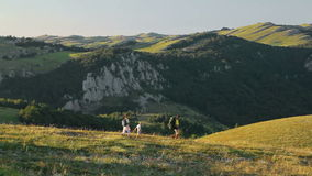 Family on a trekking day in countryside stock footage
