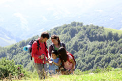 Family on a trekking day in mountains Royalty Free Stock Image