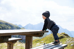 Family on a trekking day in the mountains. Mangart, Julian Alps, National Park, Slovenia, Europe. Stock Photos