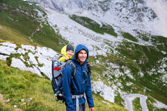 Family on a trekking day in the mountains. Mangart, Julian Alps, National Park, Slovenia, Europe. Royalty Free Stock Photography