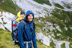 Family on a trekking day in the mountains. Mangart, Julian Alps, National Park, Slovenia, Europe. Royalty Free Stock Images