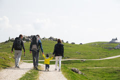 Family on a trekking day in the mountains. Velika Planina or Big Royalty Free Stock Image