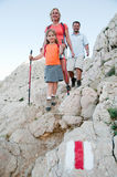 Family trekking on red trail Royalty Free Stock Photos