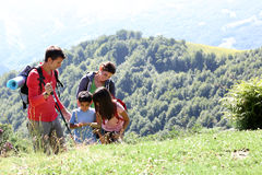 Family on a trekking trip hiking Royalty Free Stock Image