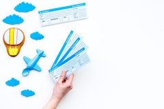 Family trip concept. Airplan toy, air balloon cookie, airplan tickets on white background top view copy space. Family trip concept. Airplan toy, air balloon Stock Images