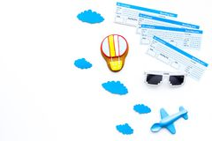 Family trip concept. Airplan toy, air balloon cookie, airplan tickets on white background top view copy space. Family trip concept. Airplan toy, air balloon Stock Image