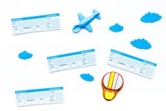 Family trip concept. Airplan toy, air balloon cookie, airplan tickets on white background top view.  Stock Photo