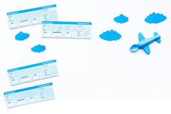 Family trip concept. Airplan toy, clouds, airplan tickets on white background top view copy space. Family trip concept. Airplan toy, clouds, airplan tickets on Stock Photo