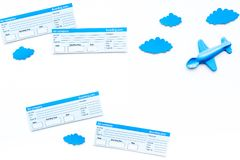 Family trip concept. Airplan toy, clouds, airplan tickets on white background top view copy space. Family trip concept. Airplan toy, clouds, airplan tickets on Stock Photography