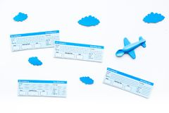 Family trip concept. Airplan toy, clouds, airplan tickets on white background top view.  Stock Photos