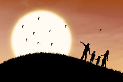 Family trip on sunset silhouette Royalty Free Stock Photography