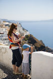 Family trip to Europe. Young mother with two kids exploring Greek town Stock Photography
