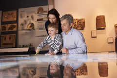 Family On Trip To Museum Looking At Map Together Stock Photography