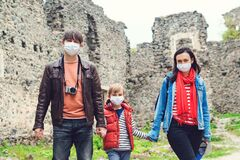 Free Family Trip To Old Castle. Parents With Son Wearing Face Masks Outdoors Royalty Free Stock Image - 182612196