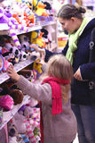 Family trip to the store. Mother and daughter in a children's toy department, make a purchase Stock Photos