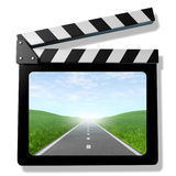Family trip video. Symbol featuring a clap bopard film slate and a road with a sky Royalty Free Stock Photography