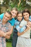 Family at tropic hotel garden Royalty Free Stock Photos