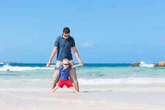 Family at the tropical beach Stock Images