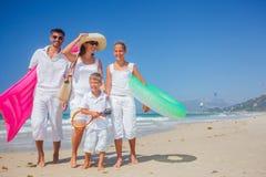 Family on tropical beach Royalty Free Stock Photo