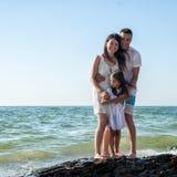 Family on tropical beach Royalty Free Stock Photos