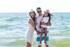 Family on tropical beach Royalty Free Stock Photography