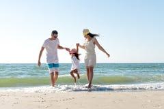 Family on tropical beach Stock Photo