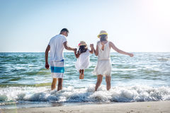 Family on tropical beach. Family of three having fun on tropical beach Stock Image