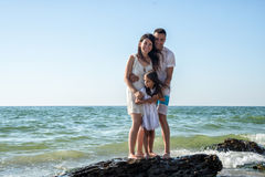 Family on tropical beach Stock Images