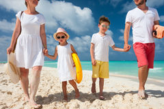 Family on a tropical beach vacation Stock Images