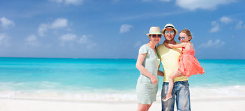 Family on a tropical beach vacation Stock Image