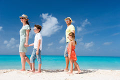Family on a tropical beach vacation Royalty Free Stock Image