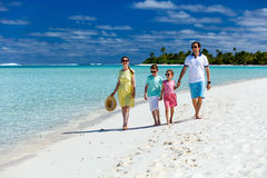 Family on a tropical beach vacation Stock Photography