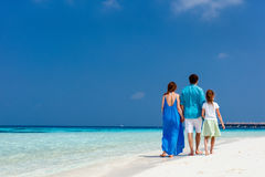 Family on a tropical beach vacation Royalty Free Stock Photography