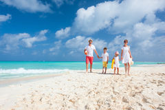 Family on a tropical beach vacation Royalty Free Stock Images