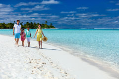 Family on a tropical beach vacation Royalty Free Stock Photos